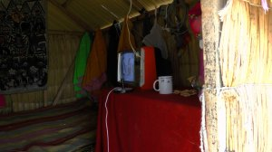 interior of one of the huts -- the solar panel powered the TV