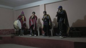 the musicians played traditional Andean music on guitar, drums, and panpipe