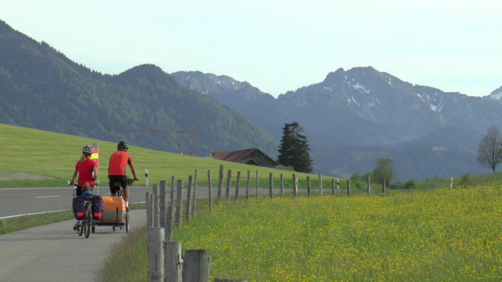 Here are Kaia and Cam in southern Germany, feeling safe as they cycle on a path separated by a grass buffer from the highway.