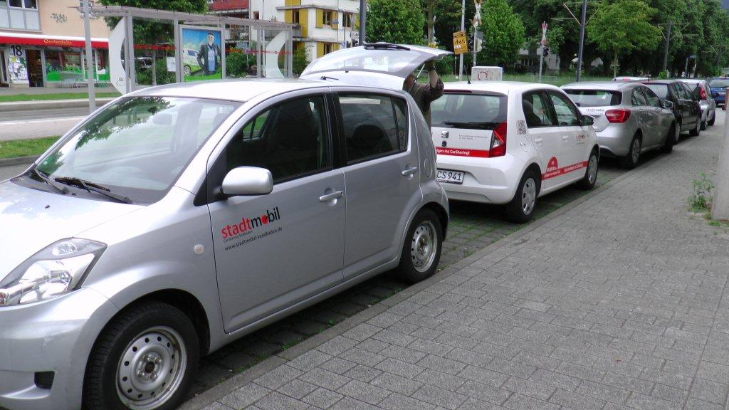 The transportation plan in Freiburg includes a car-share program, whereby members can book a suitable vehicle for the days or hours they need it.  They calculate that it is a cheaper option for people who drive fewer than 10 000 km per year.