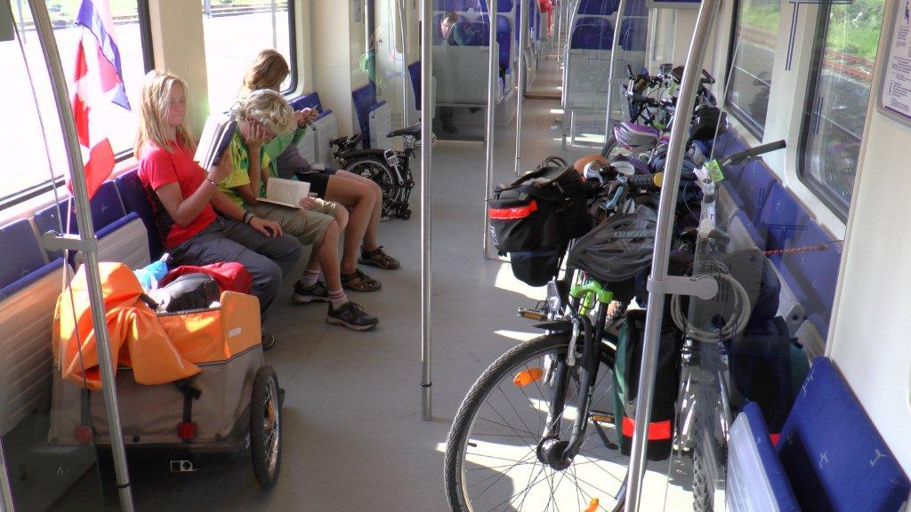 Most trains have cars designated for bicycles. Here we are travelling comfortably from X to Y.