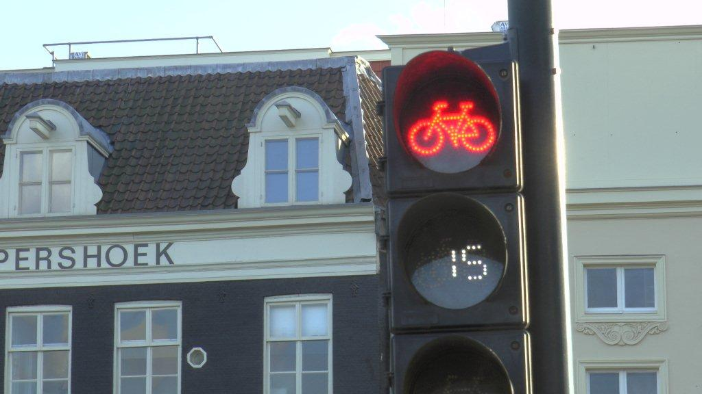 Separate traffic lights for bicycles will often count down, showing how much longer until a green light.